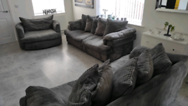 Two 3 seater sofas and swivel armchair