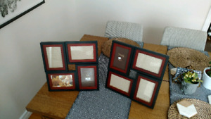 "Two Picture Frames each holding four 4x6"" photos"