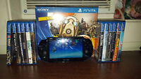 ps vita with games and a case