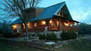 Log home on 80 subdividable acres
