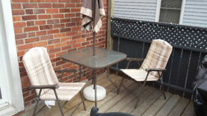 Outdoor table and 4 chairs with umbrella and stand