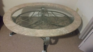 Marble coffee table iron on bottom and  glass in centre