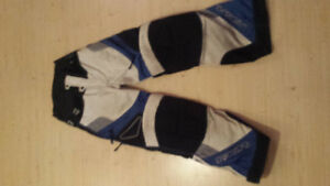 Two pair of FX dirt bike pants.
