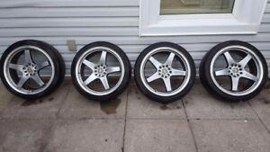 Enkei EV5 18x7.5 + Falken 215/40R18 Tires.