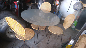 39.5 inch diameter glass top table and 3 chairs