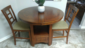 Virtually brand new dining room table/6 chairs..COUNTER HEIGHT