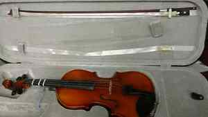 3/4 violin and bow.