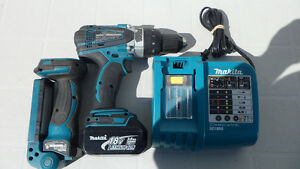Makita DHP458 18 Volt Hammer Drill and Charger $180