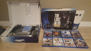 ps4 with 2 controllers and 8 games