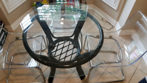 Black wicker base table with glass top and 4 acrylic chairs
