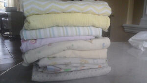 8 receiving blankets and 2 swaddling blankets