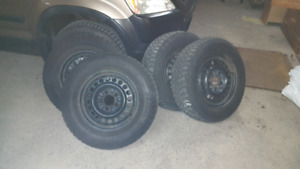 4  p 205/70R 15 Snowtracker tires on Steel rims