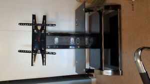"TV Stand, built in Mount for up to 65"" TVs. Steel/Glass"