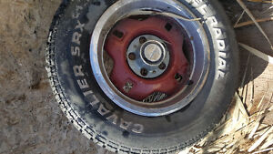 4 14in ford rims and tires.