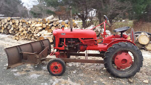 1950s International Harvester Farmall Cub Tractor w/ Plow