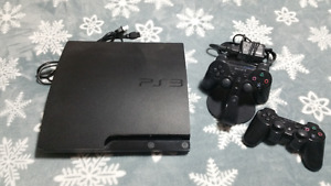 PS3 Slim console, 2 controllers + charging cradle