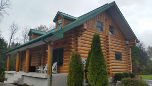 Log Home Restoration (Stipping, Staining & Chinking)