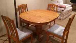 Oak kitchen table.  Solid   with chairs.