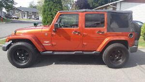 2009 Jeep Sahara Unlimited 16999$