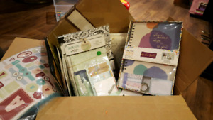 Box full of scrapbooking and craft supplies