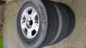 4-2010 Ford F-150 wheels/tires (one tire damaged)