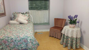 Twin bedding set + White metal twin headboard + decorator table