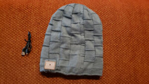 New bluetooth hat toque with speakers. Rechargeable by USB. $10.