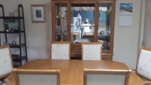 Dining table with leaf extension, 6 chairs and a China Cabinet.