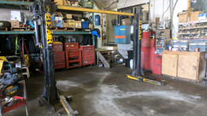 2 post automotive hoist from professional auto garage