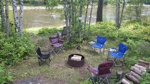 RV Lot for sale on river with Toyhauler Trailer