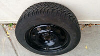 4 x 235/55R17 GoodYear winter tires on Ford Escape rims