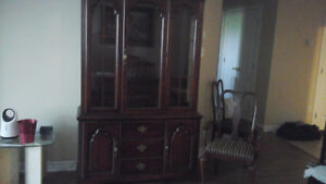 Solid wood dining table, leaf, 6 chairs and hutch.