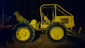 Skidder and chainsaw operator