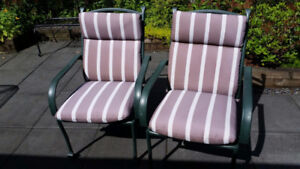 2 light weight metal deck chairs with outdoor cushions