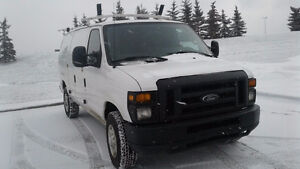 2009 Ford E-250 Cargo Van with Roof Rack and Shelving - $8995
