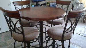 Pub style dinning set with 4 swivel chairs