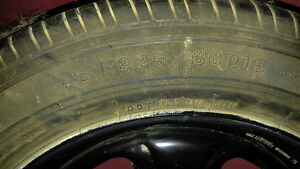 4 used goodyear p225 60 r18 tires all season.