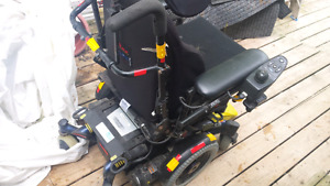 Electric wheelchair with a tilt back seat