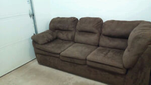 Like new! Dark chocolate brown Microfiber Leon's lounging couch