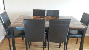 Beautiful faux marble dinning table with 6 chairs Cornwall Ontario image 1