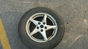 Snow tires on Pontiac Grand Prix wheels London Ontario image 1
