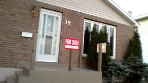 Newly-Renovated Home For Sale in Timmins.  New shingles!