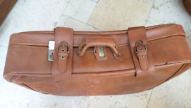 Free leather suitcase