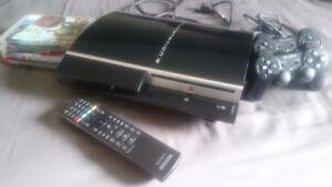 Playstation 3 w/ 4 games, 2 controllers, and remote