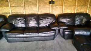Black leather couch, love seat and recliner chair. Free delivery