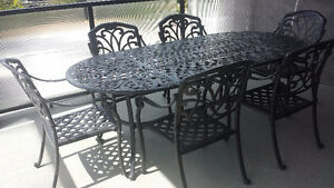 Outdoor cast iron dining set with 6 chairs