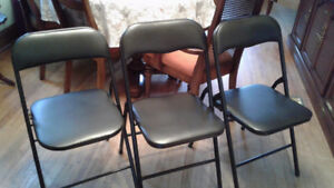 Three Black Folding Chairs