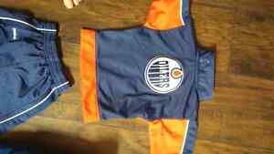 Toddlers Oilers track suit and oilers baby carrier cover