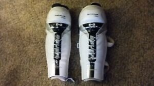 Hockey shoulder pads and shin pads