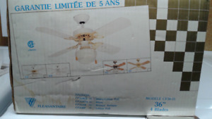 White ceiling fan with light. (in box)